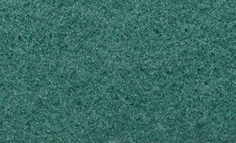 Green, fibrous texture of the fabric. Tissue texture Royalty Free Stock Photo