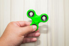 Green Fidget finger spinner toy image stock photo