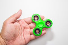 Green Fidget finger spinner toy image royalty free stock image