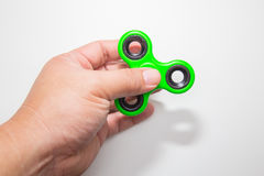 Green Fidget finger spinner toy image stock images