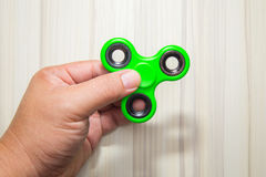 Green Fidget finger spinner toy image royalty free stock photo