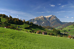 Green field. And mountain stock photography