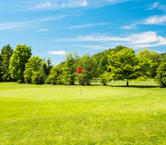 Green field and beautiful blue sky. golf course Stock Images