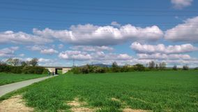 Green field bike the traffic and clouds. Video stock video footage