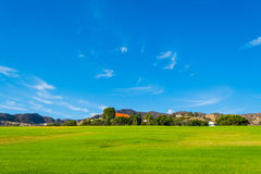 Green field and blue sky in California Royalty Free Stock Photography