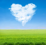 Green field blue sky with cloudy heart Stock Image