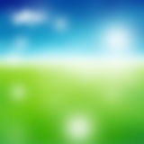 Green field and blue sky. With white cloud Stock Photo