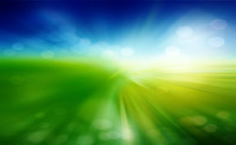 Green field and blue sky. With white cloud Stock Images