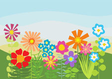 Green field with bright multicolored flowers Stock Photo