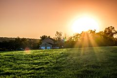 Green Field and Brown and White House during Sunrise Stock Photo