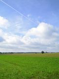 Green field in countryside Stock Image