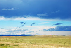 Green Field and Distant Blue Mountains Royalty Free Stock Photos