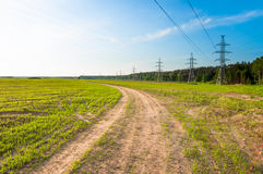 Green field, electricity line Royalty Free Stock Photos