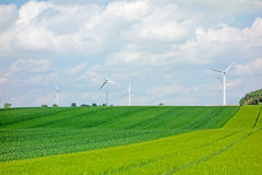 Green field, farmland with windmills Royalty Free Stock Photo