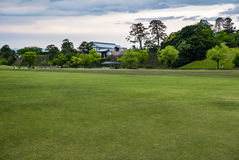 Green field in front of Kanazawa castle Stock Photo