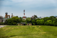 Green field in front of Kanazawa castle Royalty Free Stock Photography