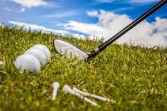 Green field with golf equipment Stock Photos