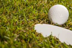 Green field with golf equipment Stock Image
