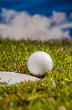 Green field with golf equipment Royalty Free Stock Image