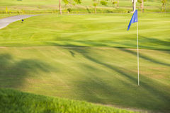 Green field golf with flag Royalty Free Stock Photos