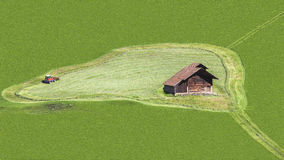 Green Field with House and  Mower Stock Images