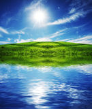 Green field and lake Royalty Free Stock Photography