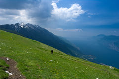 Green field and lake in mountains. Lake Garda as seen from Mountain Baldo in North Italy Royalty Free Stock Photos