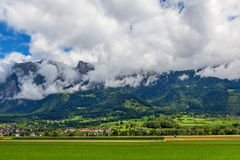 Green field and mountains in Germany. Stock Photo