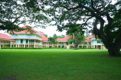 Green field and  Mrigadayavan Palace Royalty Free Stock Photography