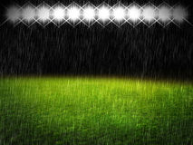Green field at night with rain. Green field at night scene with lights Stock Photos