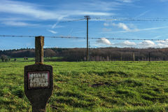 Green field and null for text. Green field with fence of iron wire in background power line stock images