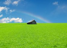 Green Field with old Cabin Royalty Free Stock Photography
