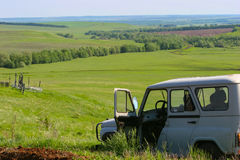 Green field and open agronomist car Royalty Free Stock Photography