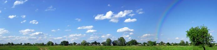 Green Field Panorama With Rainbow Stock Image