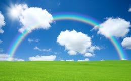 Green field and rainbow Royalty Free Stock Photos