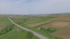 Green field with road. drone video. stock footage