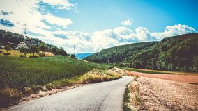 Green Field and Road in Landscape Photography Stock Images