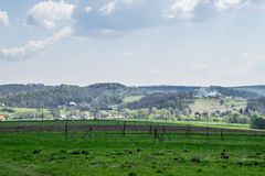 Green field in the shade and hill in the sun. Nature of traditional ukrainian village royalty free stock photography