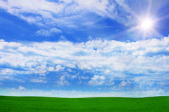 Green field,sky and sun. Royalty Free Stock Photos