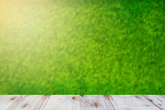 Green field under blue sky. Wood planks floor. Beauty nature background. At Thailand Stock Photography