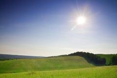 Green field in village Stock Photo