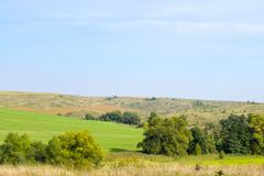Green field and virgin land. Contrast of green field and virgin land in Ukraine stock photos