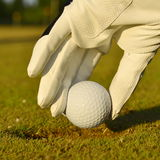 Green field and white golf ball sanset Stock Photos