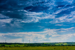 Green Field. With wind propellers at skyline Stock Images