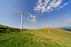 Green field with wind turbines Stock Images