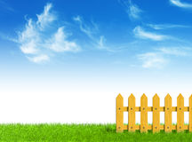 Green field and wooden fence Royalty Free Stock Photos