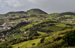 Green fields and cottages inland on the island of Pico Stock Photos