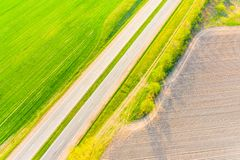 Green fields and dry soil along the road. Aerial landscape in countryside stock images
