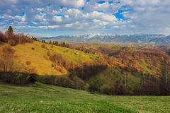 Green fields and high mountains in spring. Beautiful spring panorama in Transylvania,Romania Stock Image