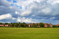 Green fields and houses Royalty Free Stock Images